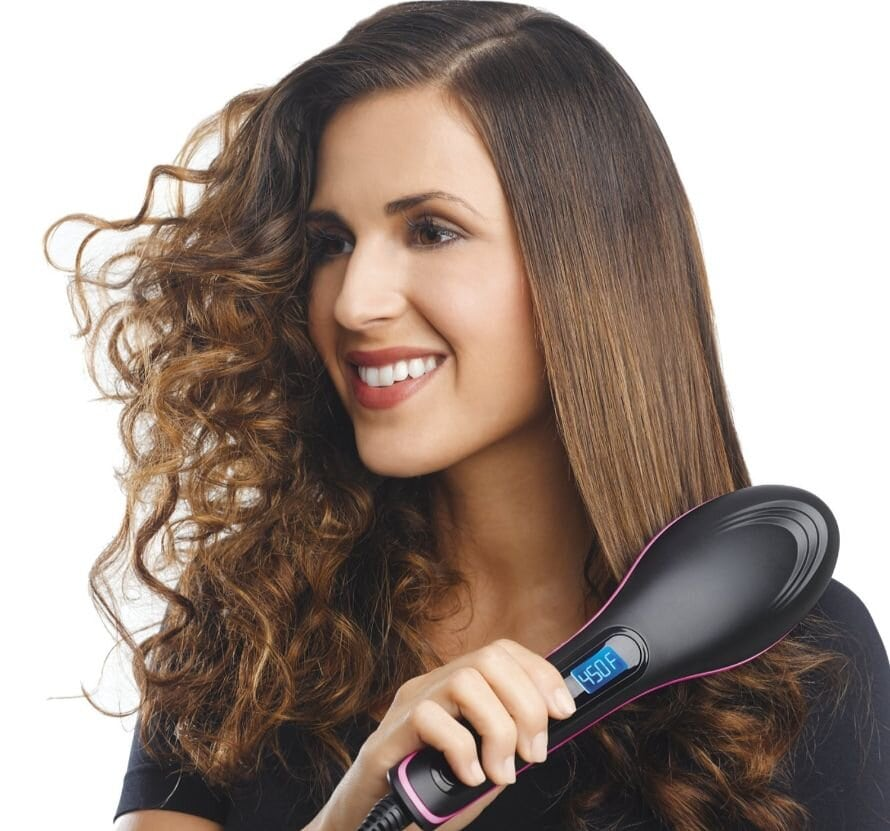Girl straightens her hair with the brush