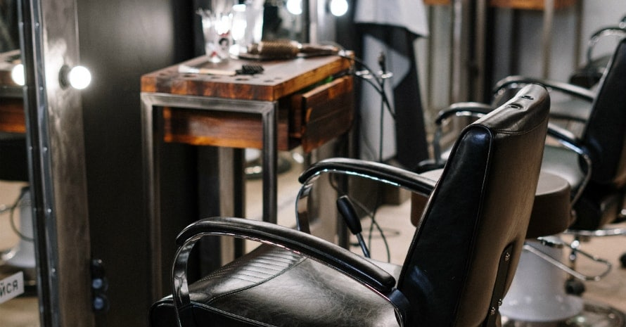 black-leather-barber-chair-in-front-of-mirror