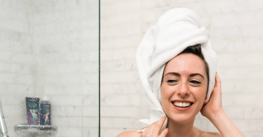 girl smiling with a towel on her head