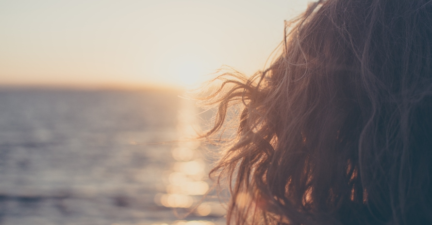 Girl's hair from background of the sea